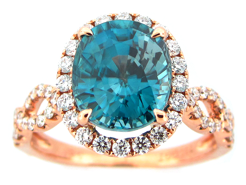 Blue Zircon & Diamond Halo Twist Ring